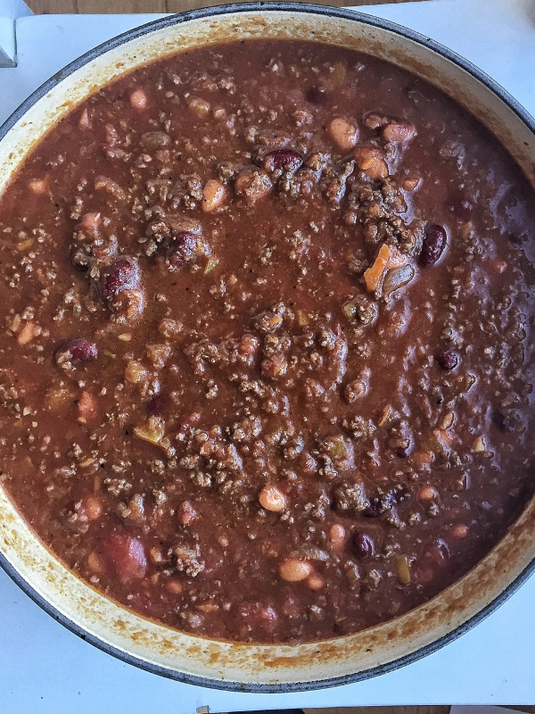 A basic chili recipe that is meaty, hearty, and can feed 10-12 people! A straightforward, starter recipe for anyone wanting to learn how to make homemade chili.